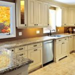 A striking light tan modern luxury kitchen interior with solid surface countertops