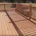 Sierra Remodeling raised deck with beautiful hand railing and post caps