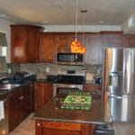 Sierra Remodeling kitchen remodel cherry cabinets stainless appliances and granite counters